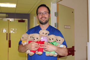 male-nurse-with-bears